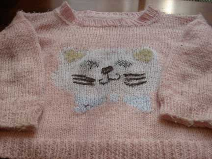 Hand-knit sweater with kitten face on front